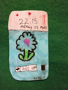 En teckning av en mobiltelefon med en blomma på skärmen.