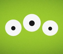 Tre vita cirklar med svarta små cirklar inuti på grön botten.