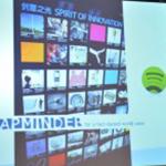 Projicerad presentation med bland annat Spotify-loggan.