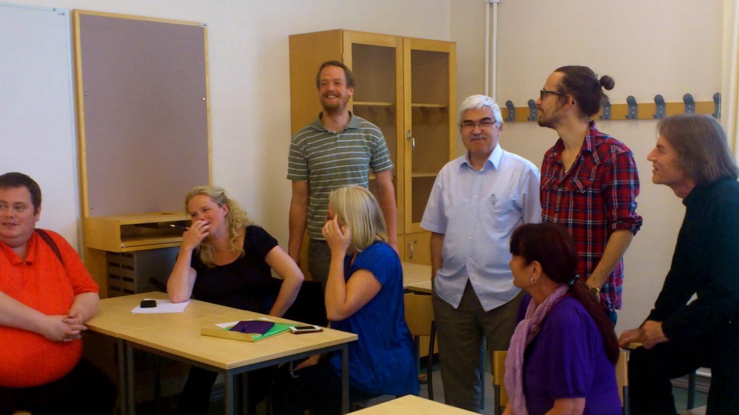 Åtta pedagoger sitter i klassrum.