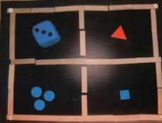 Fyra delar med olika figurer i.