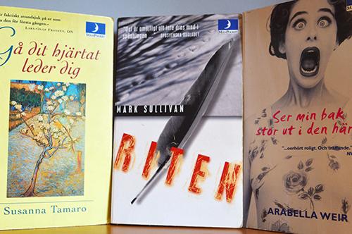 Tre bokomslag på rad.