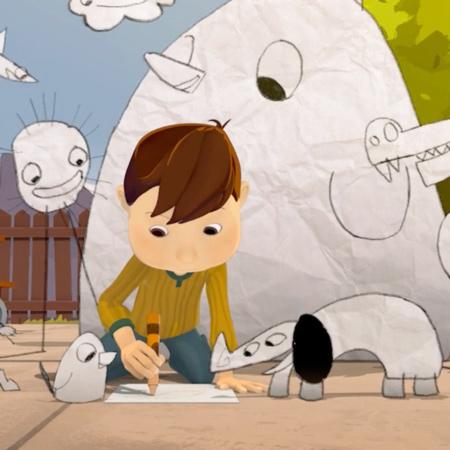 Tecknad pojke sitter och ritar på marken.