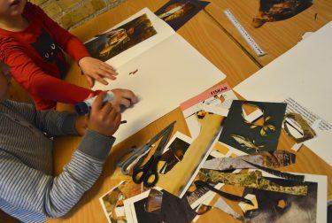 Barn klipper ut djur från papper.