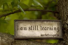 Skylt med citat av Michelangelo.