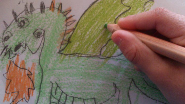 Barn ritar en drake.