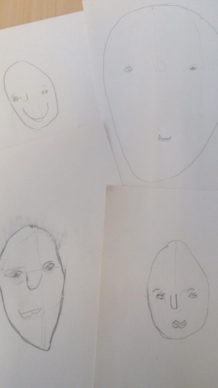 Fyra tecknade porträtt.