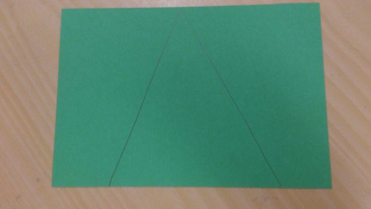 Triangel utritad på papper.