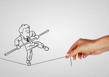 Tecknad man balanserar på tråd.