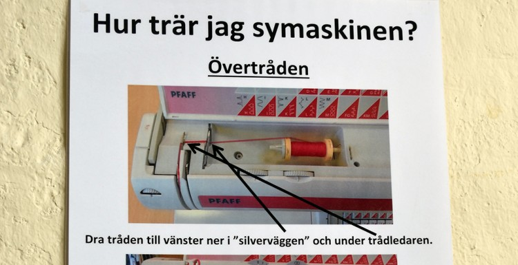 Instruktion för att trä symaskin.