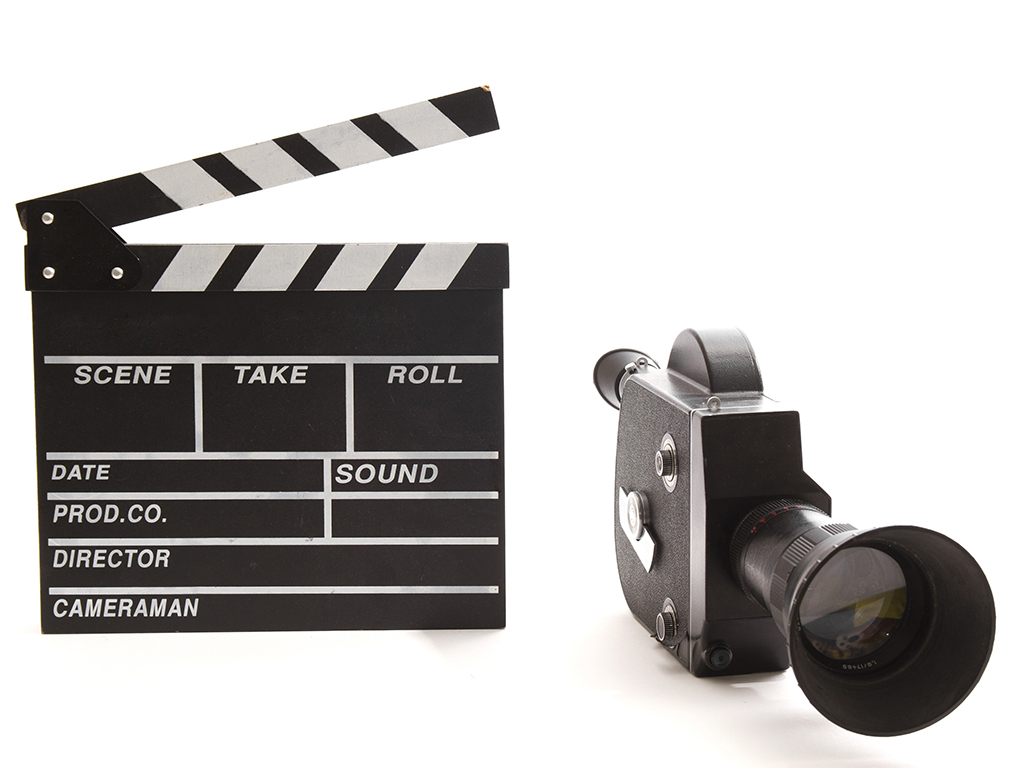 Filmkamera och filmklappa.