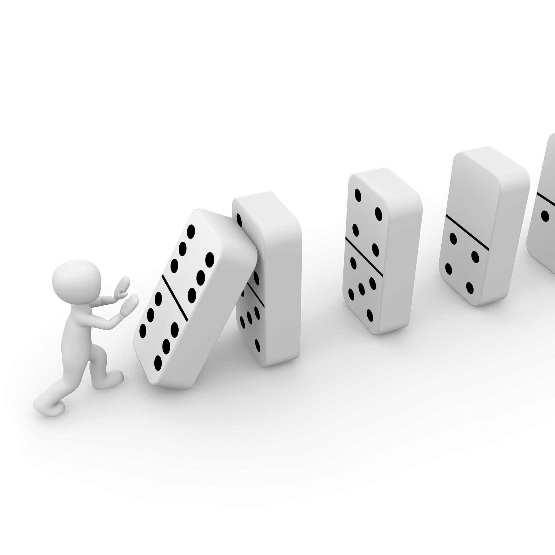 3D-människa puttar på dominobrickor.