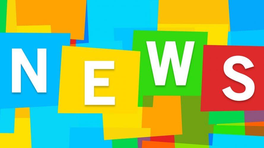 Ordet news bildas av färgglada block