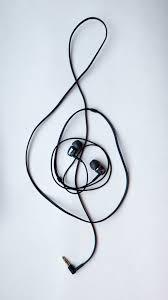 En g-klav formad av hörlurar.