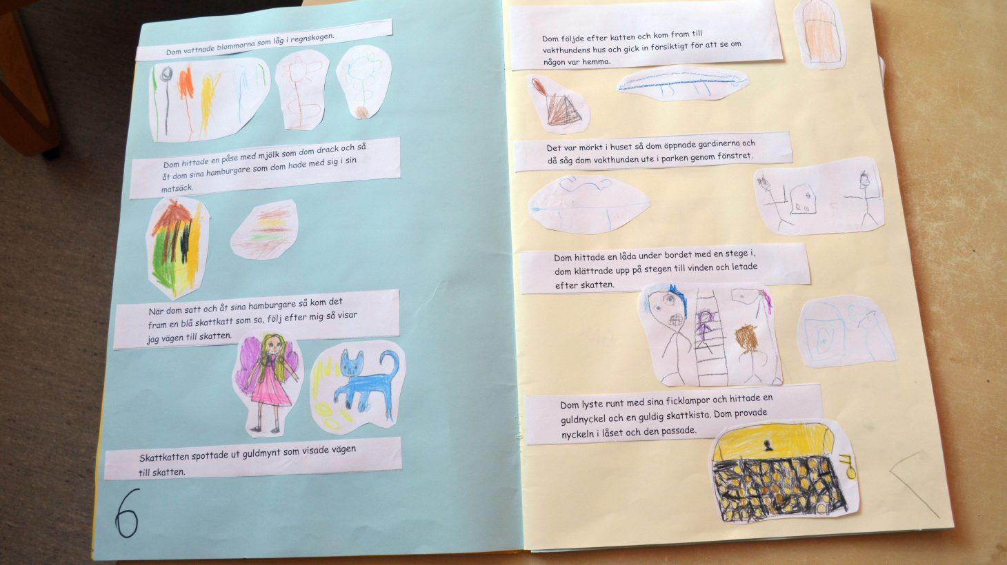 En öppen sagobok som förskolebarn skrivit och ritat.