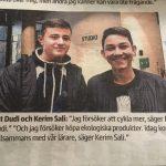 Tidningsurklipp med två elever.