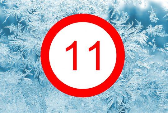 Rimfrost på ruta med siffran elva i rund röd ring.
