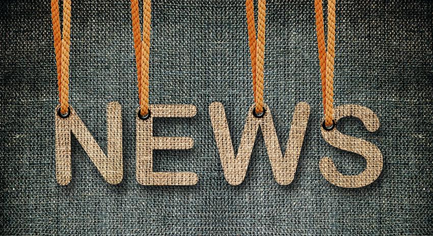 "Ordet ""news"" i textilmaterial."